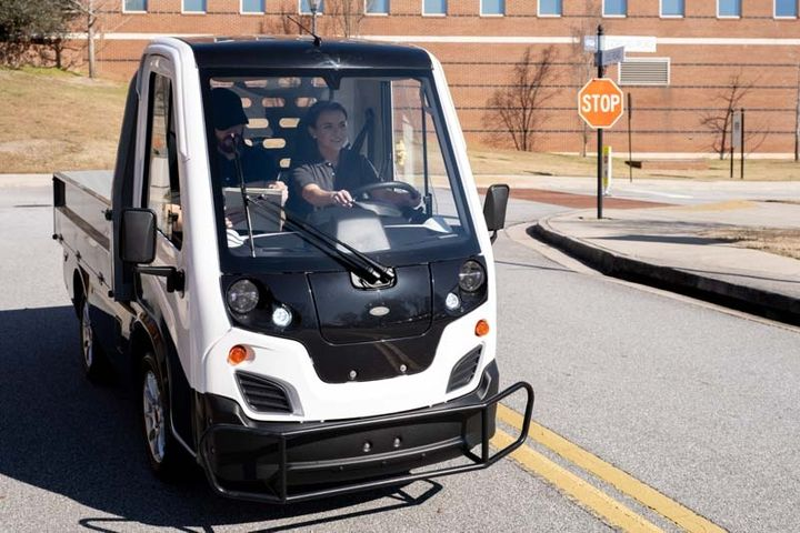 The Club Car Current is a compact all-electric light-duty truck equipped with automotive features and comforts. - Photo: Club Car