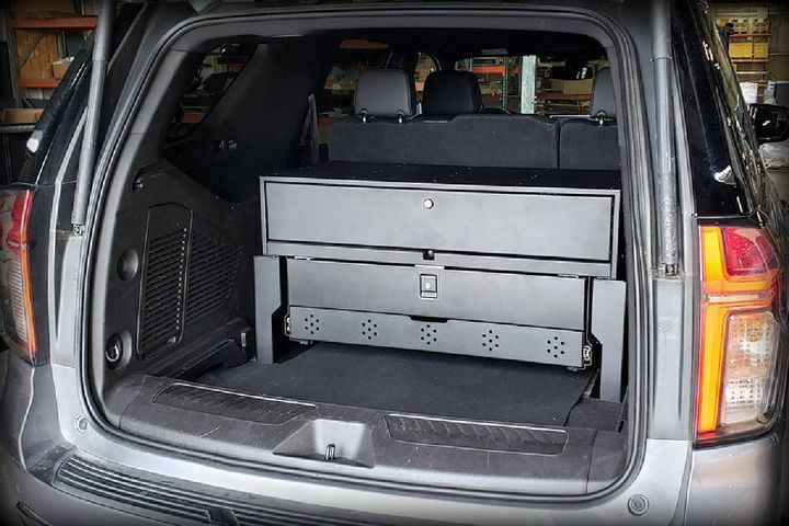 The mounting solution allows upfitters and end users to easily remove the trim panel covering the battery to gain much needed access to power in the rear of the vehicle. - Photo:Estes AWS