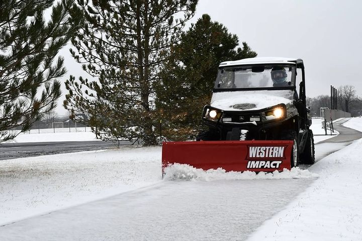 The Impact mid-duty UTV plow features hydraulic positioning and a lightweight design that is tailoredfor mid-duty recreational utility vehicles. - Photo: Western Products