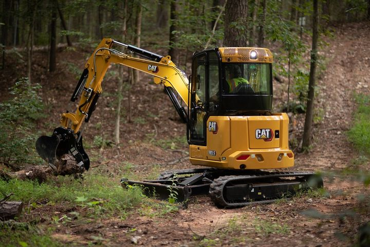 Design enhancements for the new 302.7 CR, 303 CR, and 303.5 CR deliver up to 10% more performance in travel and trenching. - Photo: Caterpillar