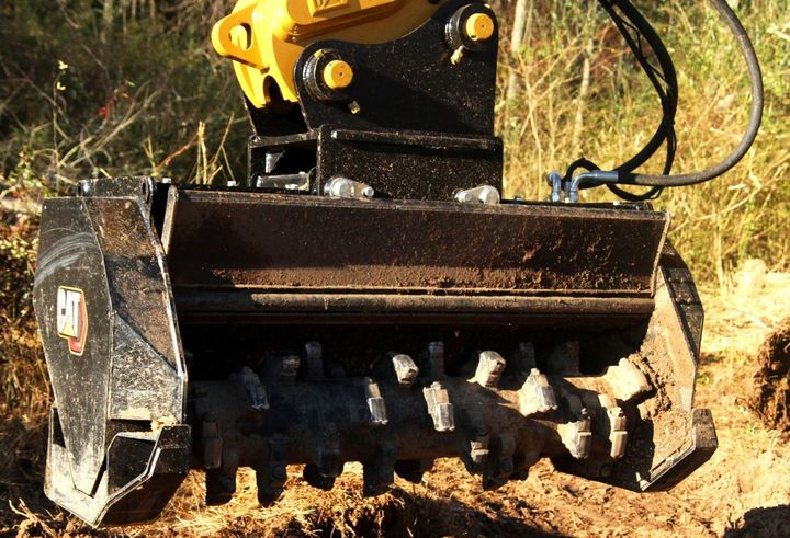 The ability to adjust the hydraulic mulching door on Caterpillar's new980 XE and 982 XE mulchersallows the operator to control the material throw, increasing operating safety. - Photo: Caterpillar