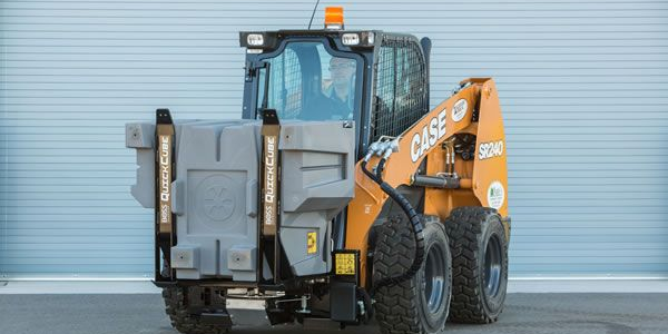 The Quickcube is pictured with a skid steer loader. Photo courtesy of Boss