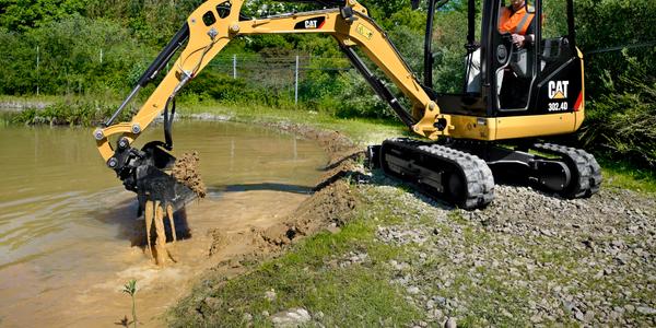 Cat 302.4D Mini Excavator cleaning a pond
