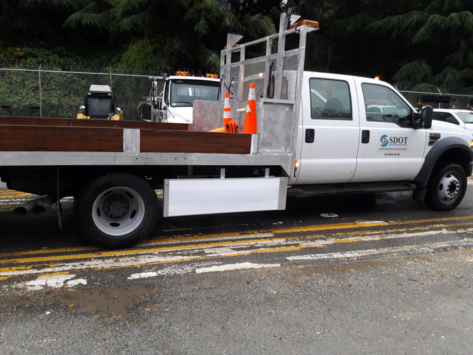 Image of Seattle DOT F-Series truck equipped with Walker Side Guard courtesy of Walker. -