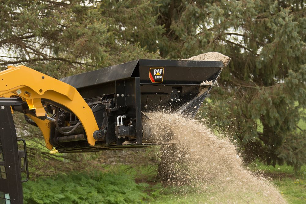 Cat Side Discharge Buckets Provide Controlled Flow of Loose Materials