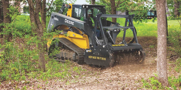 John Deere's mulching head attachment has a three-position heavy-duty push bar helps protect the...