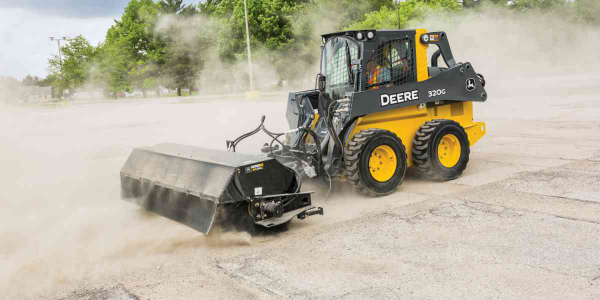 John Deere's angle broom features a hydraulic-angling range of 30 degrees to the right or left...