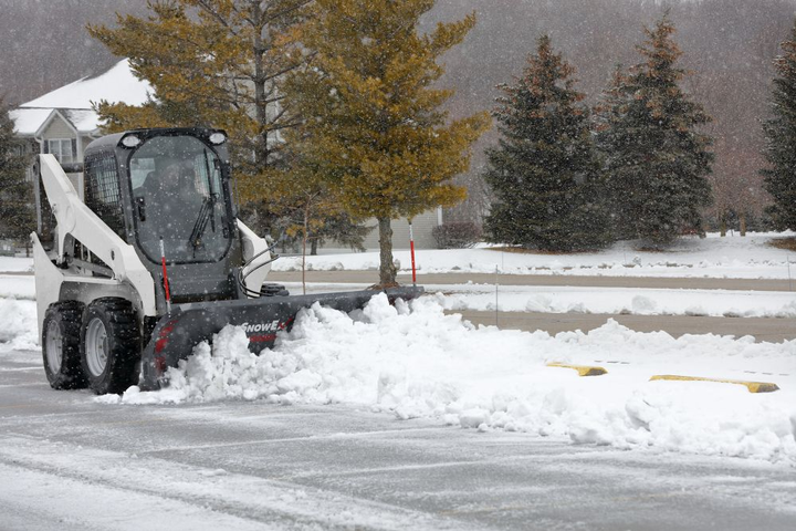 The SnowEx oscillating skid-steer mount can be used forits Heavy-Duty (HD) and Speedwing snowplows.  - Photo courtesy of SnowEx