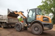 Case's 321F compact wheel loader features operating weight of13,303 lbs. and lift capacity...