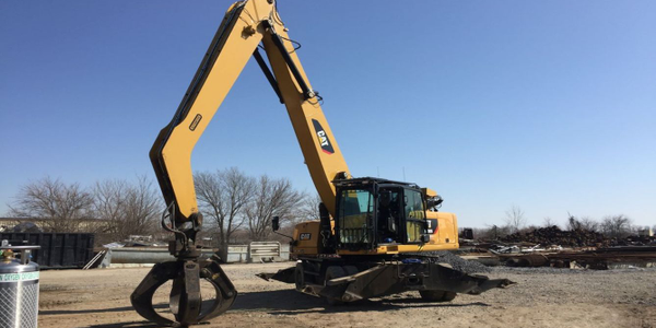 Caterpillar's new grappler can be used with Caterpillar material handlers.
