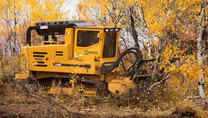 Morbark's Rayco T415 forestry machine is ideal for land clearing, construction, pipeline work, electric utility work, and real estate development.