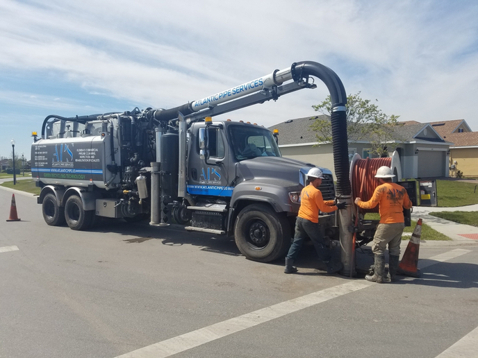 Gradall's Vacall AllJetVac R Series model, with a rear-mounted hose reel and boom, accommodates operators who prefer to work away from engine noise.  - Photo courtesy of Gradall