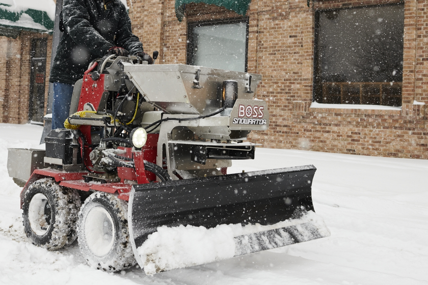 The Boss Snowrator plows and de-ices sidewalks and walkways.