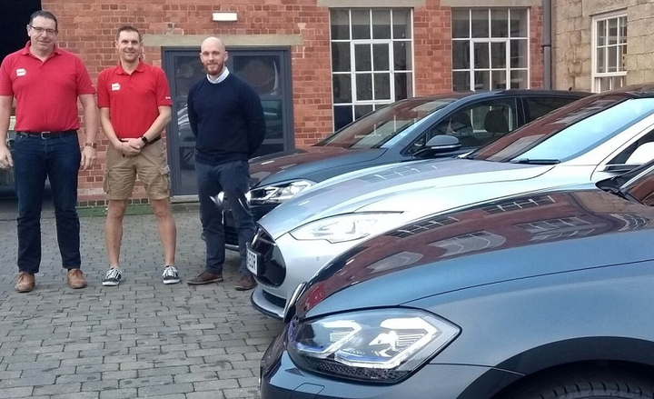 (l. to r.) Posing in front of Chevin's new alt-fuel vehicles are Stephen de Launay, global senior product specialist for Chevin, Gareth Roulston, projects team lead for Chevin, and Ashley Sowerby, managing director for Chevin.