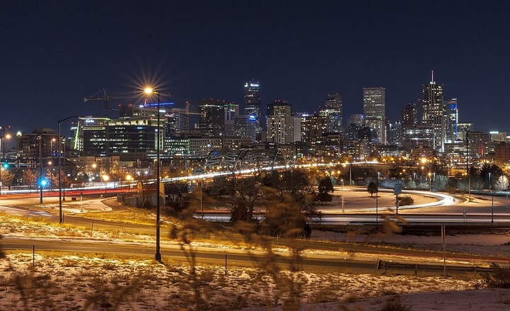 The state currently offers a $5,000 tax credit for passenger electric vehicles and partners with the private sector to build fast charging stations along Colorado's major highways. - Photo of the Denver skyline courtesy of Pixabay