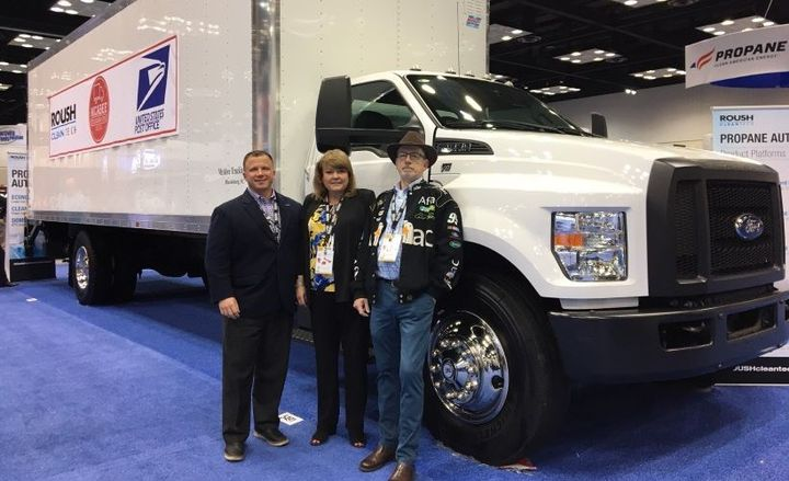 From left to right, Todd Mouw, president of ROUSH CleanTech; Lisa McAbee of McAbee Trucking; and a McAbee truck driver.  - Photo by Chris Brown.