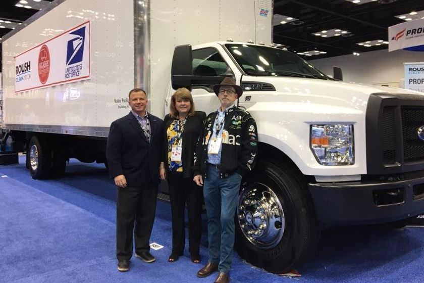 From left to right, Todd Mouw, president of ROUSH CleanTech; Lisa McAbee of McAbee Trucking; and...