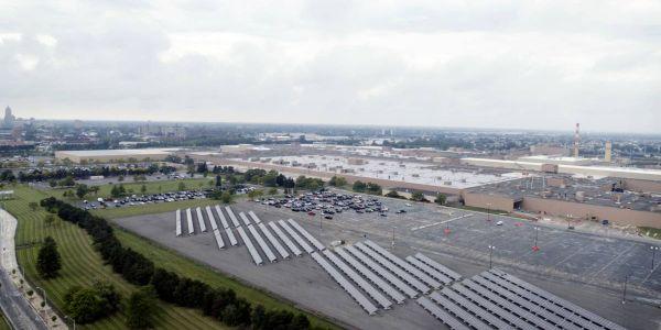 This 516-kilowatt ground-mount photovoltaic solar array at GM's factoryin Hamtramck, Mich. is...