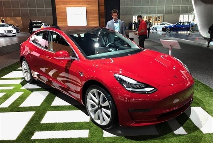 - Photo of the Tesla Model 3 by Paul Clinton.