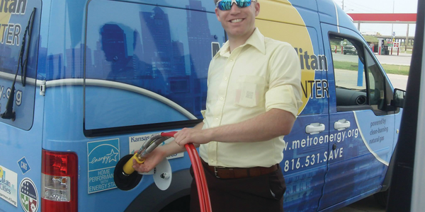 Kansas City Regional Clean Cities Coalition Co-coordinator Aaron Brown fills up the Metropolitan...