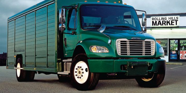 Freightliner is developing a hybrid drive system for trucks such as this beverage delivery truck.