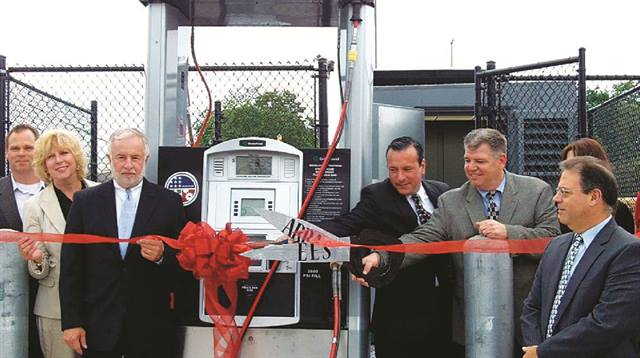 Community leaders gather for the grand opening of a compressed natural gas fueling station at Middle Country School District in Long Island in May. (L-R) Scott Zepp, Greenfield Compression; Councilwoman Kathleen Walsh, Town of Brookhaven, N.Y.; Congressman Tim Bishop; Frank Morgigno and Pat McClave, Engineered Energy Solutions; and Herb Chessler, Middle Country School District.