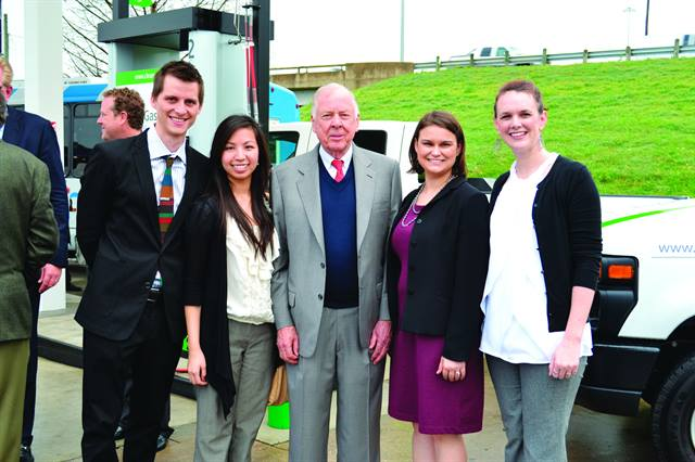 T. Boone Pickens (center) poses with Dallas-Fort Worth Clean Cities staff (from left, Kenny Bergstrom, Kimberlin To, Pamela Burns, and Mindy Mize) at the Fuel City CNG station opening.
