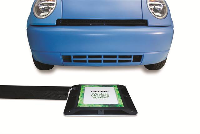 The Delphi wireless charging system involves no plugs or charging cords. Electric power flows upward from a power source resonator to a power capture resonator installed on a vehicle.
