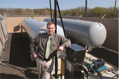 Jason Ebert, GO Riteway's fleet and facilities coordinator, stands next to the company's new propane refueling station, which was funded entirely through a Clean Cities grant.