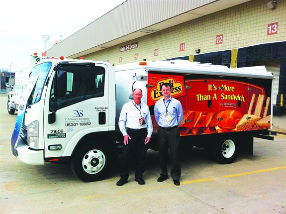 Gregg Hodgdon, CAFM, director of fleet operations at Deli Express, is shown above left with Scott Bates, truck product manager for Thermo King, in front of the fleet's new, fuel-efficient truck.
