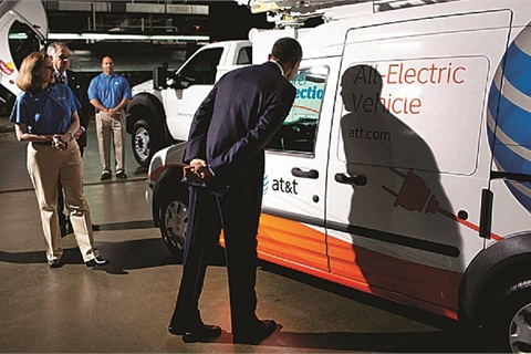 President Barack Obama inspects an AT&T all-electric vehicle on display during a tour of a UPS facility in Landover, Md., April 1, 2011.