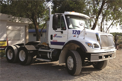 This International WorkStar 7600 is fitted with a CNG tank. Its CNG cylinders need to be protected from impact damage, road debris, and UV exposure from sunlight.