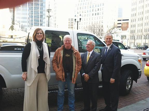 Greater Indiana Clean Cities Coalition Executive Director Kellie Walsh (left) and Indiana Rep. Randy Frye (far right) celebrate passage of legislation to support the use of alternative fuels.