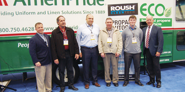 Todd Mouw (far left) of ROUSH CleanTech and AmeriPride Fleet Manager Banny Allison (third from...