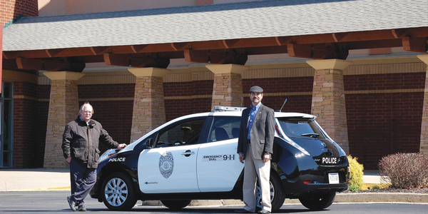 Jonathan Overly, executive director of ETCleanFuels (right), with the Kingsport, Tenn., Police...