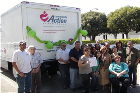 The Community Action Partnership of Orange County (CAPOC) poses with new CNG-fueled, 16-foot box truck.