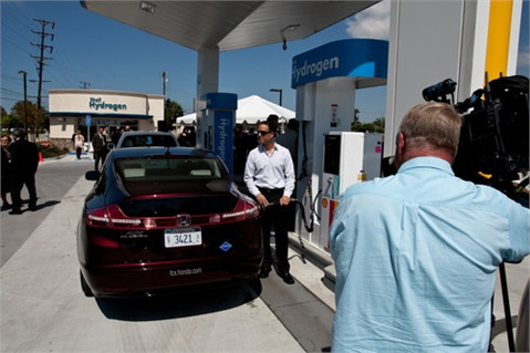 A Honda FCX Clarity fills up at the newly opened hydrogen station in Torrance, Calif.