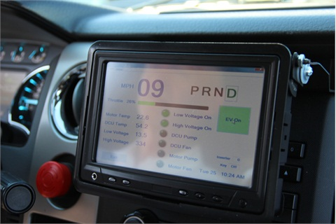 A flip-up touchscreen tablet allows drivers to select one of the vehicle's multi-modes (hybrid, all-electric, ICE).