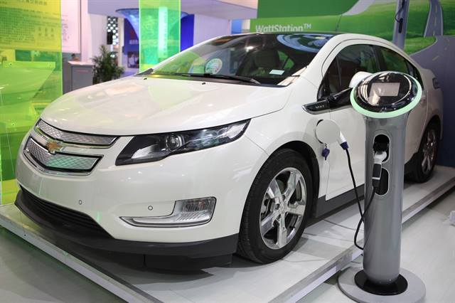 A GE WattStation charging a Chevrolet Volt