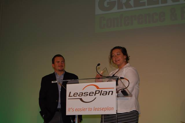 Washington Gas' Melissa Reidy accepts the CLEANFleet certification honor from Government Fleet magazine's Publisher Eric Bearly.