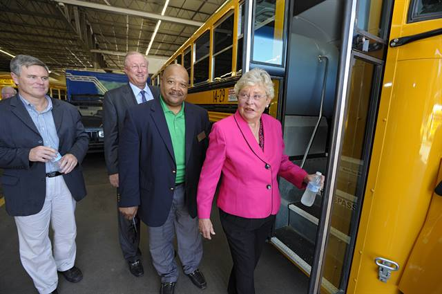 Lt. Gov. Kay Ivey, MCPSS Transportation Director Pat Mitchell, State Sen. Rusty Glover and Blue Bird Chief Commercial Officer Dale Wendell board one of the new propane autogas buses. Photo via ROUSH CleanTech