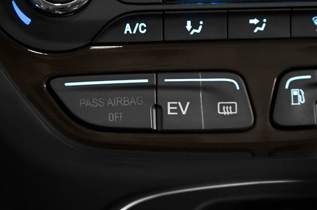 The EV mode button – mounted in the center stack – allows a driver to switch vehicle operation between three modes.