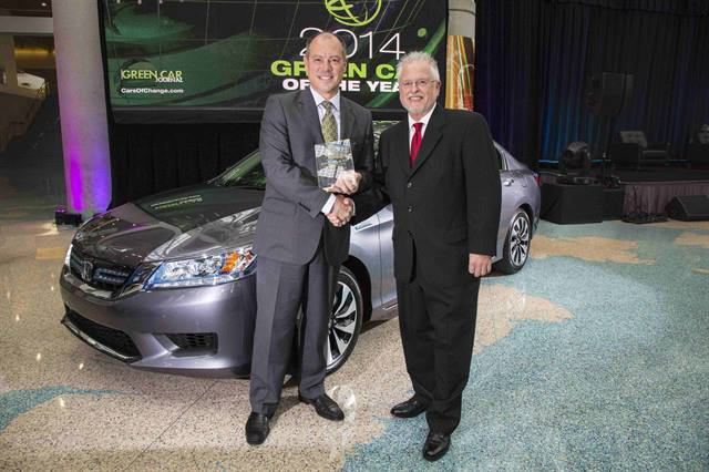 Michael Accavitti, senior vice president at American Honda, accepts the 2014 Green Car of the Year Award for the 2014 Accord from Ron Cogan, publisher of Green Car Journal. Photo courtesy of Honda.