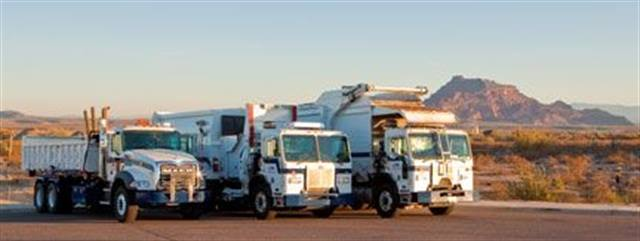 Pictured are vehicles from the Mesa Solid Waste Management Department. The department will transition in CNG refuse vehicles. Photo via City of Mesa.
