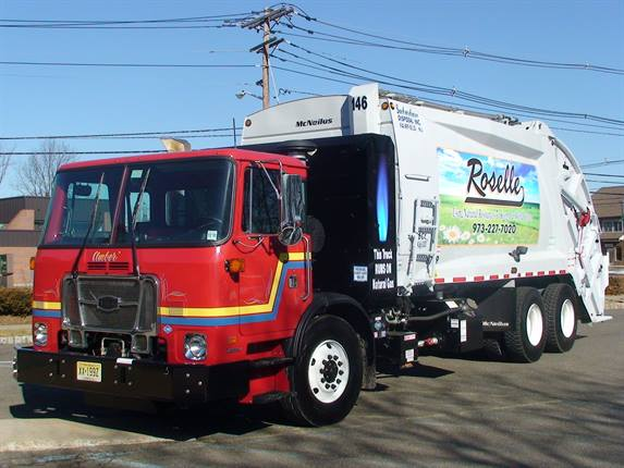 Suburban Disposal's 2012 CNG-powered Autocar refuse truck features a Cummins Westport 320 ISG Engine and a sixty-eight DGE Fuel Storage System. This vehicle was designed and supplied by Cambria Truck Center.