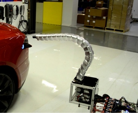 Screen capture of Tesla's 'charging snake' prototype video from Tesla Motors Twitter.