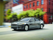 HYBRID Among the Ford Fusion Hybrid's updated features is a SmartGauge with EcoGuide. The...