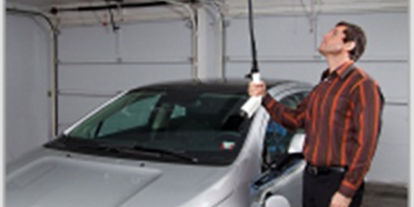 Control Module Inc.'s overhead retractable cable management system for electric vehicle charging