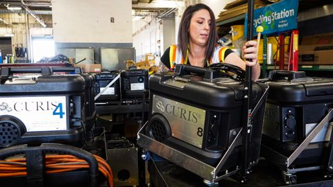 TriMet staff simply places the portable, suitcase-sized CURIS fogging device into the bus and...