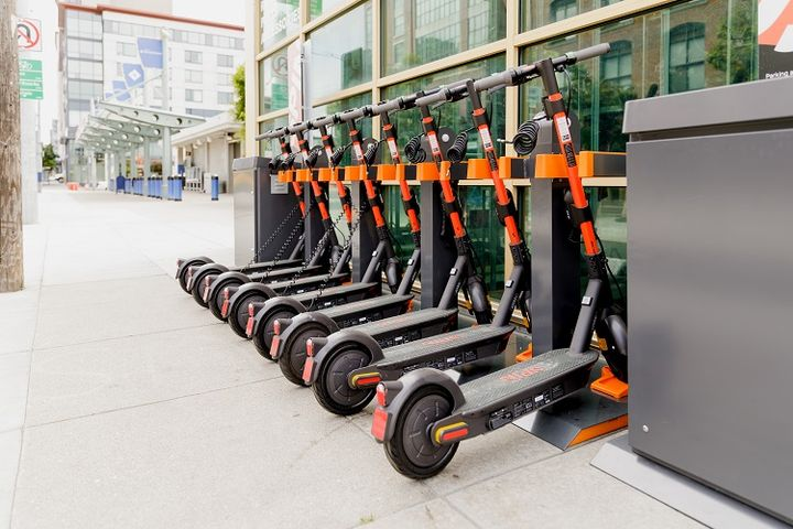 Scooter charge racks placed strategically where operators want them to start each day helps eliminate daily rebalancing while resolving their need for charging. - Spin